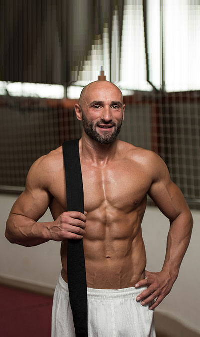 photo of man with low-body fat and great shape from doing jiu jitsu classes madison wi