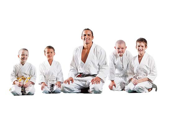 image of martial arts kids class instructor sitting with students