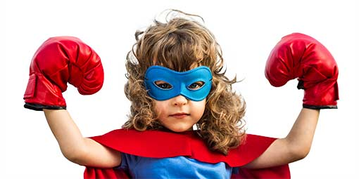 image of a student from our self defense classes for kids with superhero costume