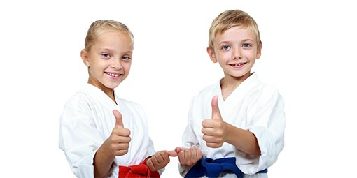image of kids martial arts madison students giving a thumbs up
