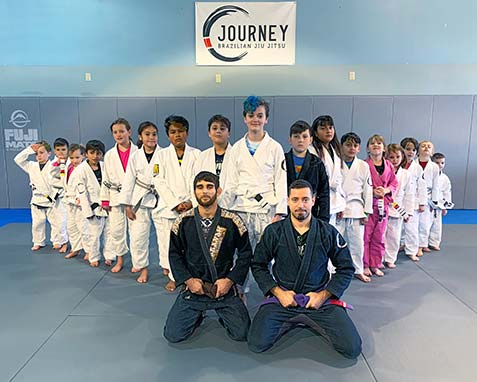 image of okids jiu jitsu madison class with instructors sitting in front of kids
